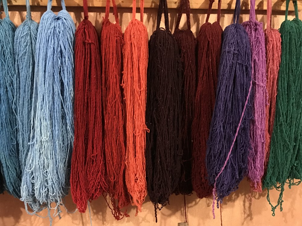 Naturally-dyed loops of yarn, waiting to be turned into gorgeous rugs and bags.