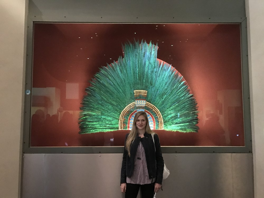 At the National Museum of Anthropology in Mexico City, Mexico, sporting Montezuma's headdress of quetzal feathers.