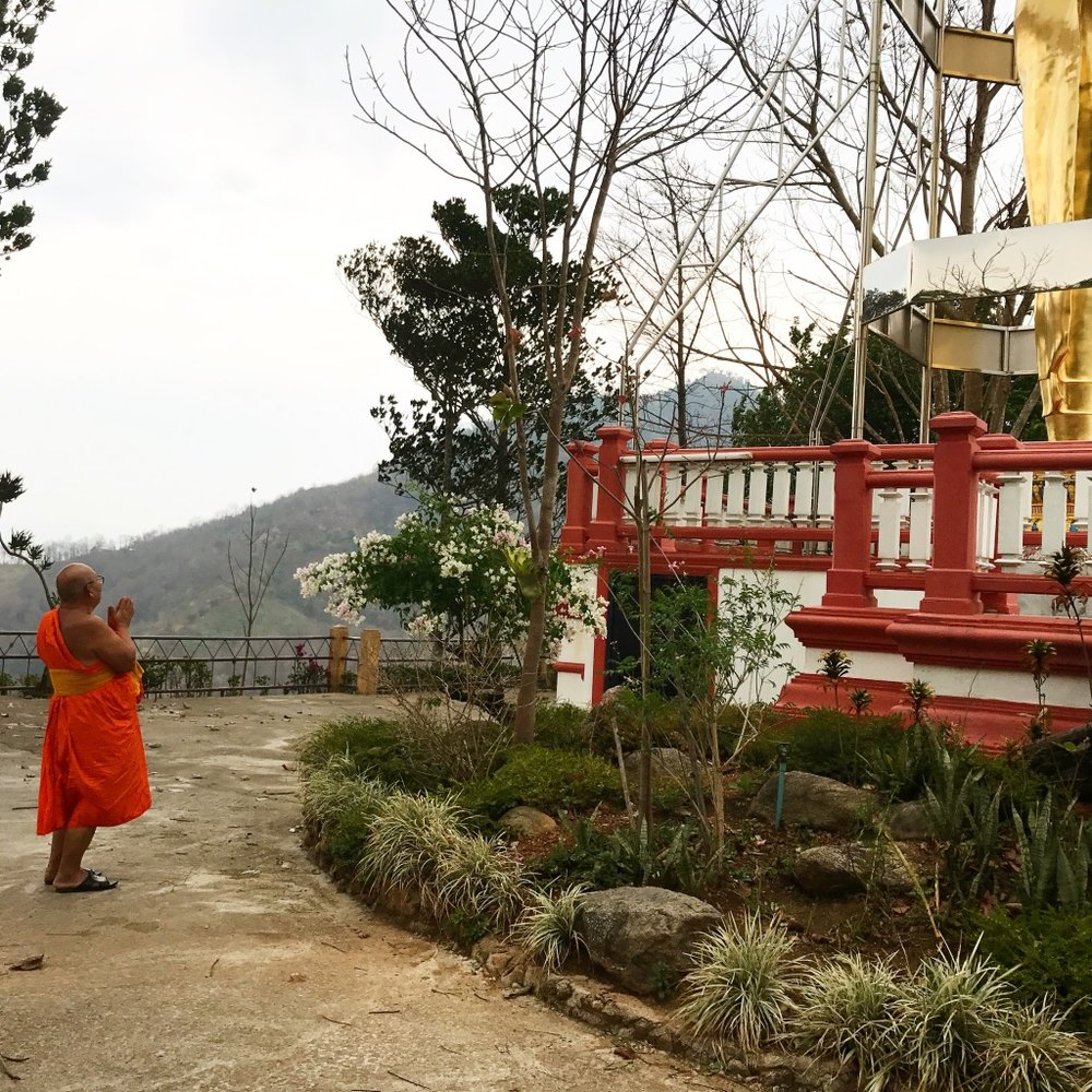 Resident Monk praying at the 9th Level of Wat Thaton, Thailand.