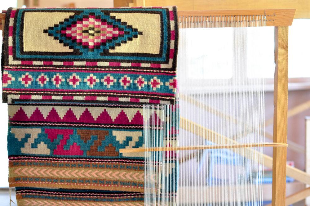 Rug weaving loom.