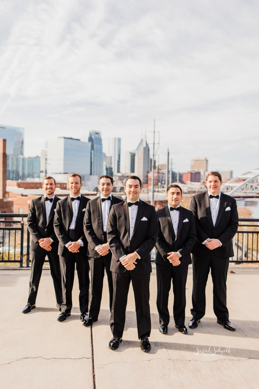 Groomsmen stand together | Sarah Sidwell Photography | The Bell Tower