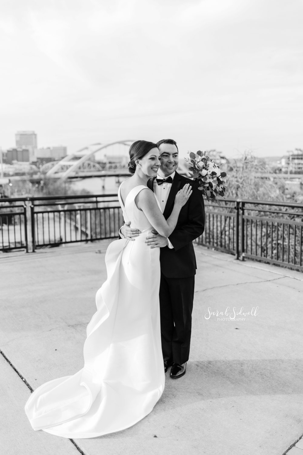 A man hugs his new wife | Sarah Sidwell Photography | The Bell Tower