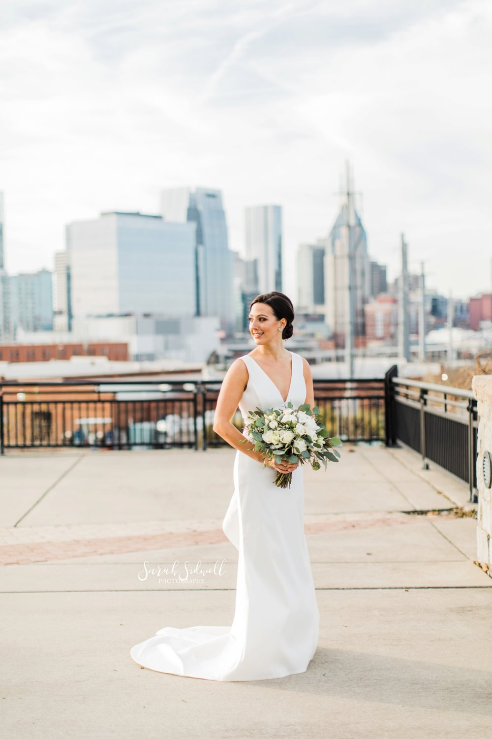 A bride stands on a rooftop | Sarah Sidwell Photography | The Bell Tower
