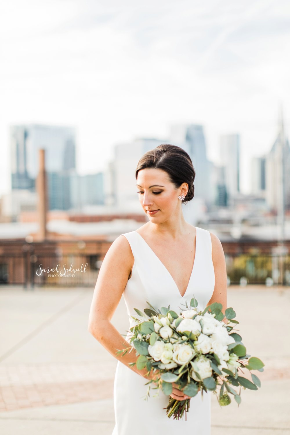 A bride glances over her shoulder | Sarah Sidwell Photography | The Bell Tower