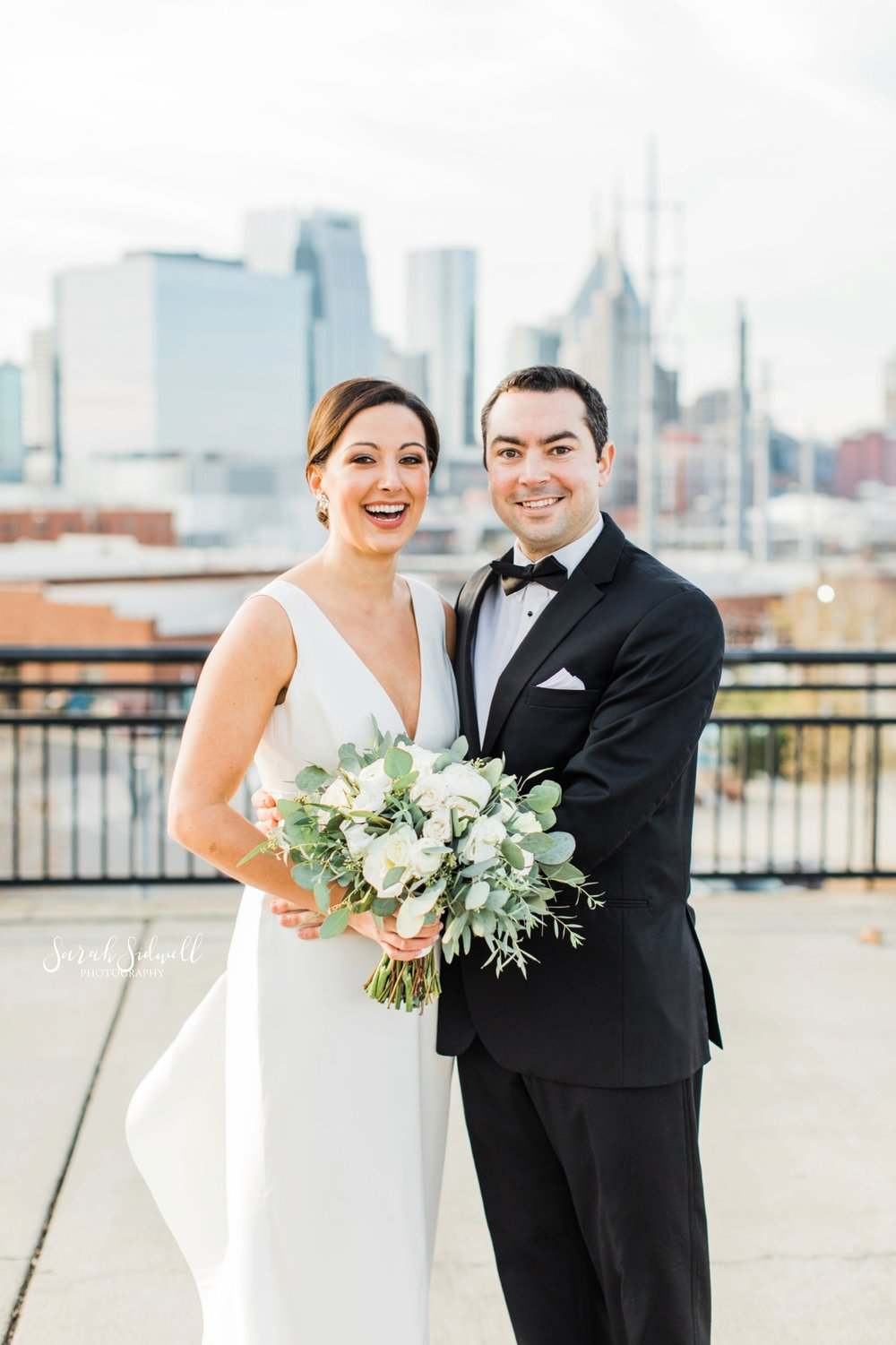 A couple pose for wedding photos | Sarah Sidwell Photography | The Bell Tower