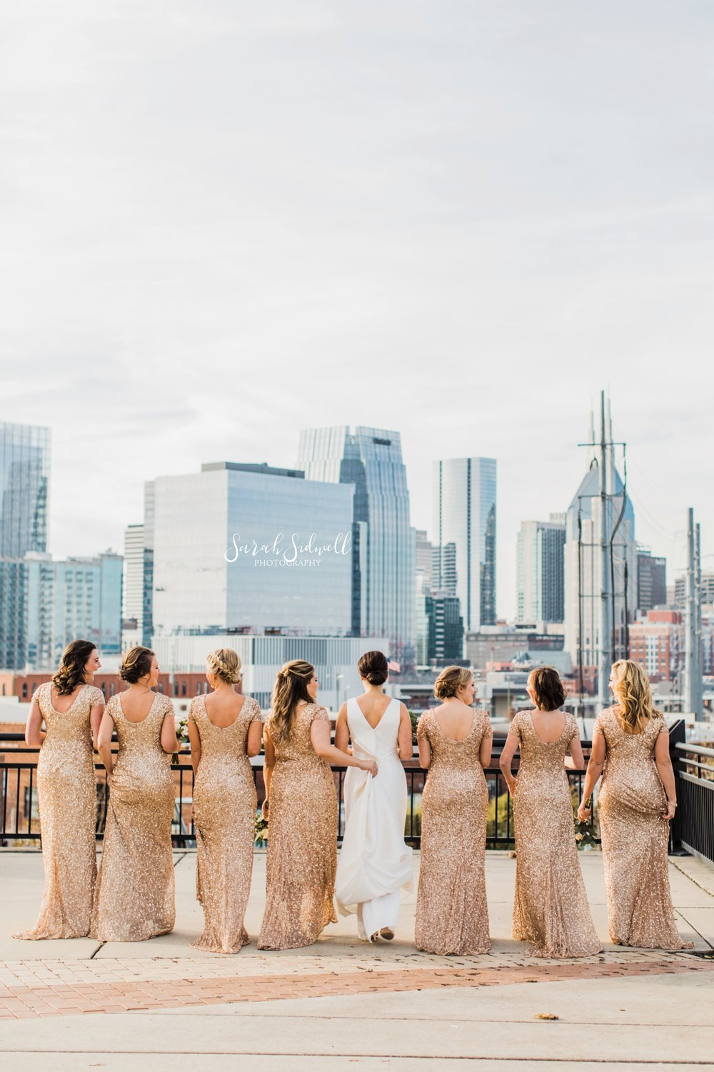 A bridal party shows off their dresses | Sarah Sidwell Photography | The Bell Tower