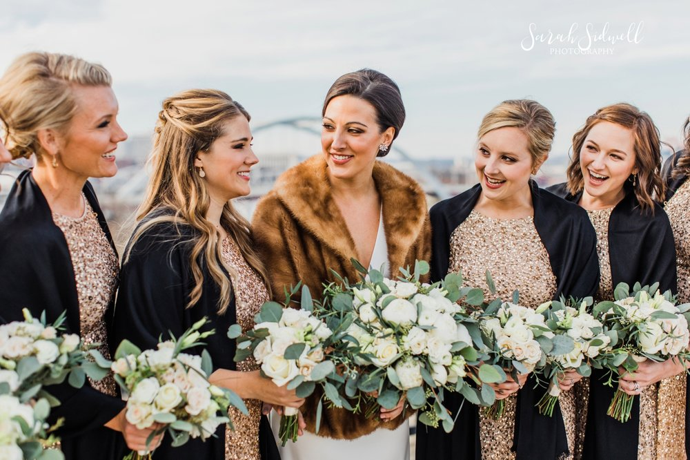 A bride wears a fur coat | Sarah Sidwell Photography | The Bell Tower