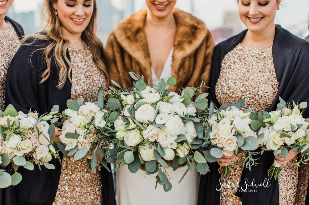 A bridal party show off their bouquets | Sarah Sidwell Photography | The Bell Tower