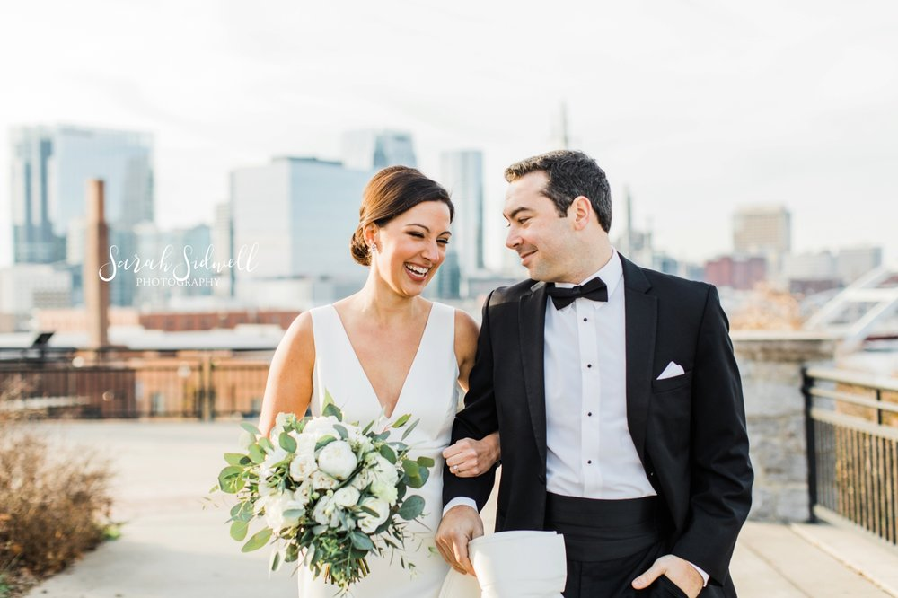 A man whispers to his new bride | Sarah Sidwell Photography | The Bell Tower