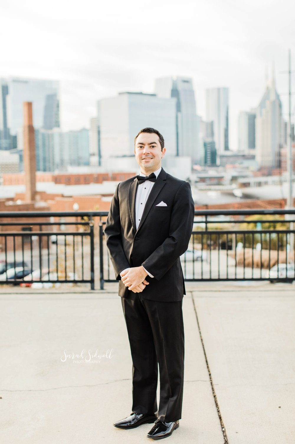 A man stands on a rooftop | Sarah Sidwell Photography | The Bell Tower