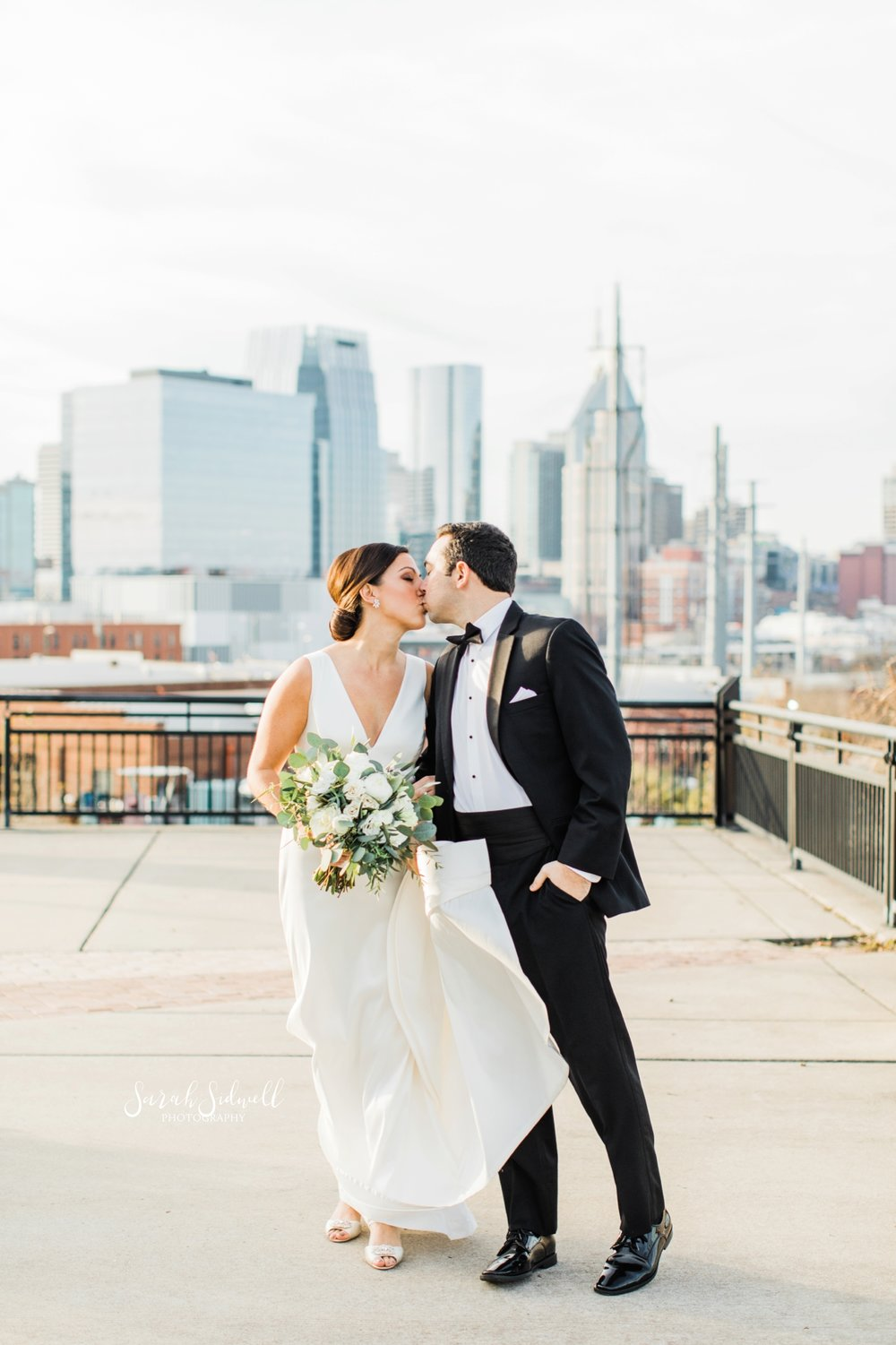A man gives his bride a kiss | Sarah Sidwell Photography | The Bell Tower