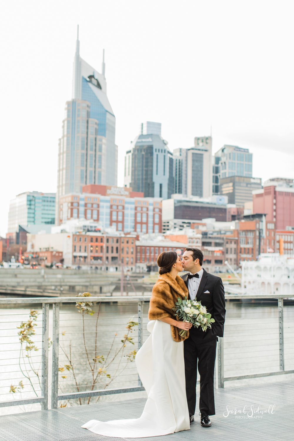 A bride and groom steal a few private moments together | Sarah Sidwell Photography | The Bell Tower