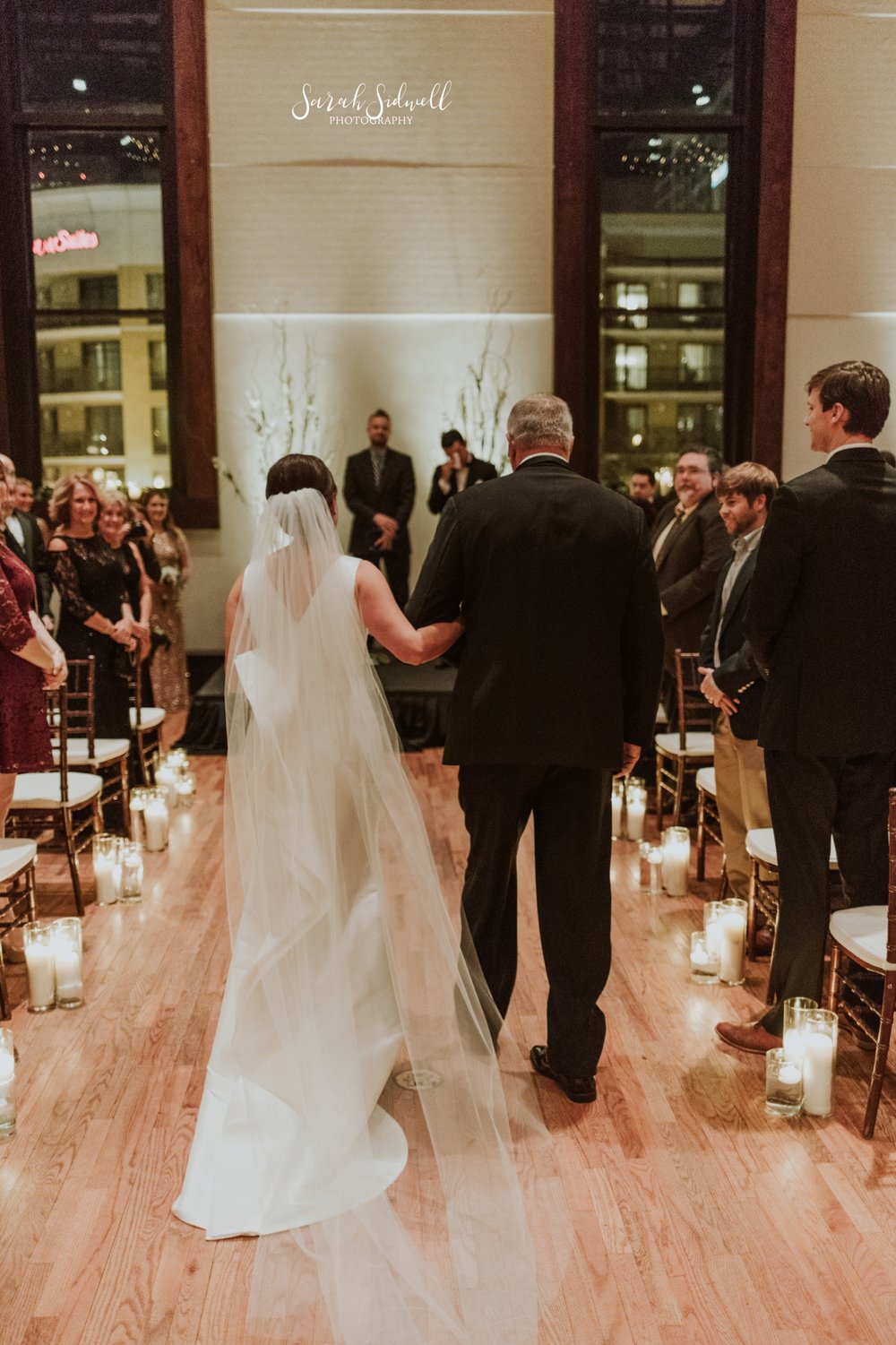 A bride walks down the aisle | Sarah Sidwell Photography | The Bell Tower