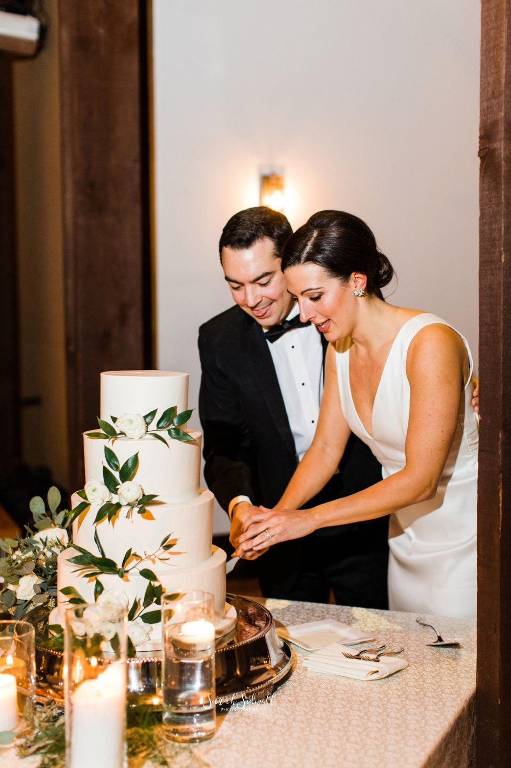 A bride and groom cut their wedding cake | Sarah Sidwell Photography | The Bell Tower