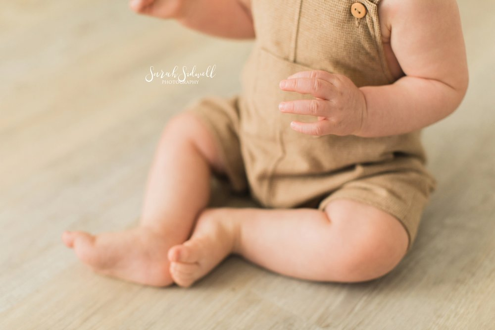 A baby crosses his legs | Sarah Sidwell Photography