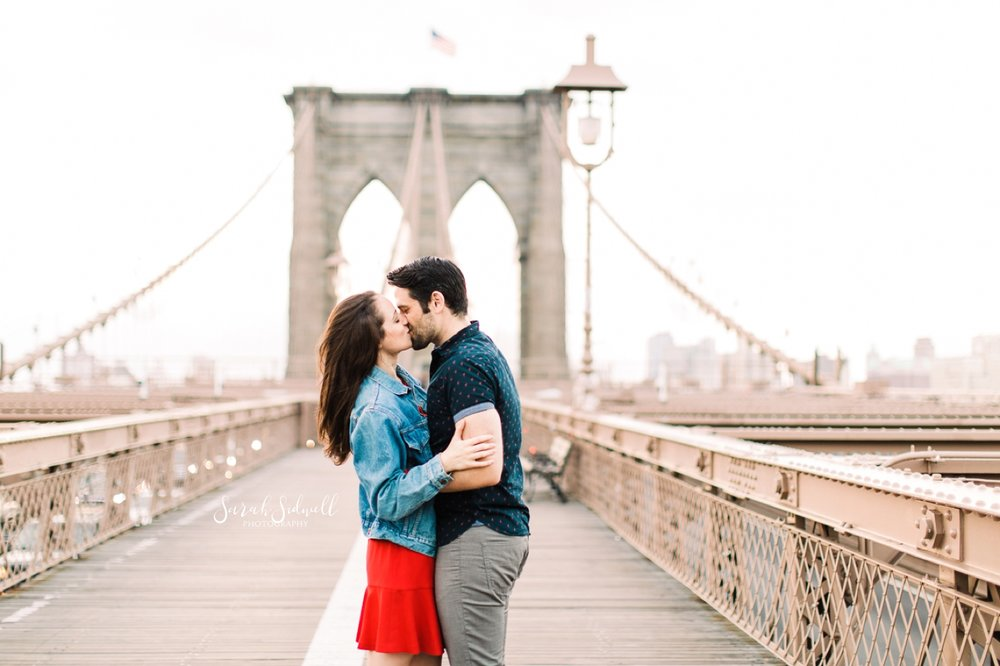 A couple kisses on a bridge. | Sarah Sidwell Photography | Nashville Engagement Photographer