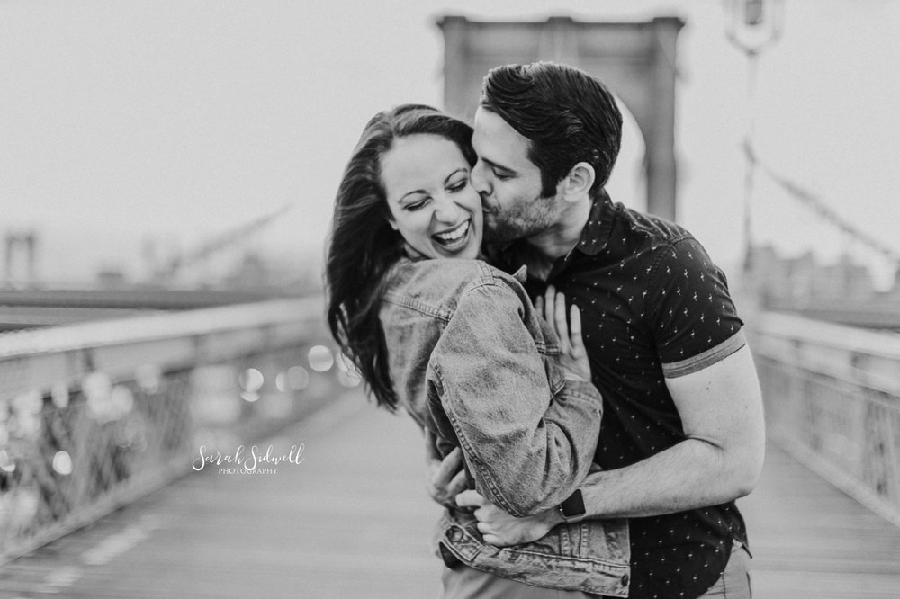 A man kisses his fiance.  | Sarah Sidwell Photography | Nashville Engagement Photographer
