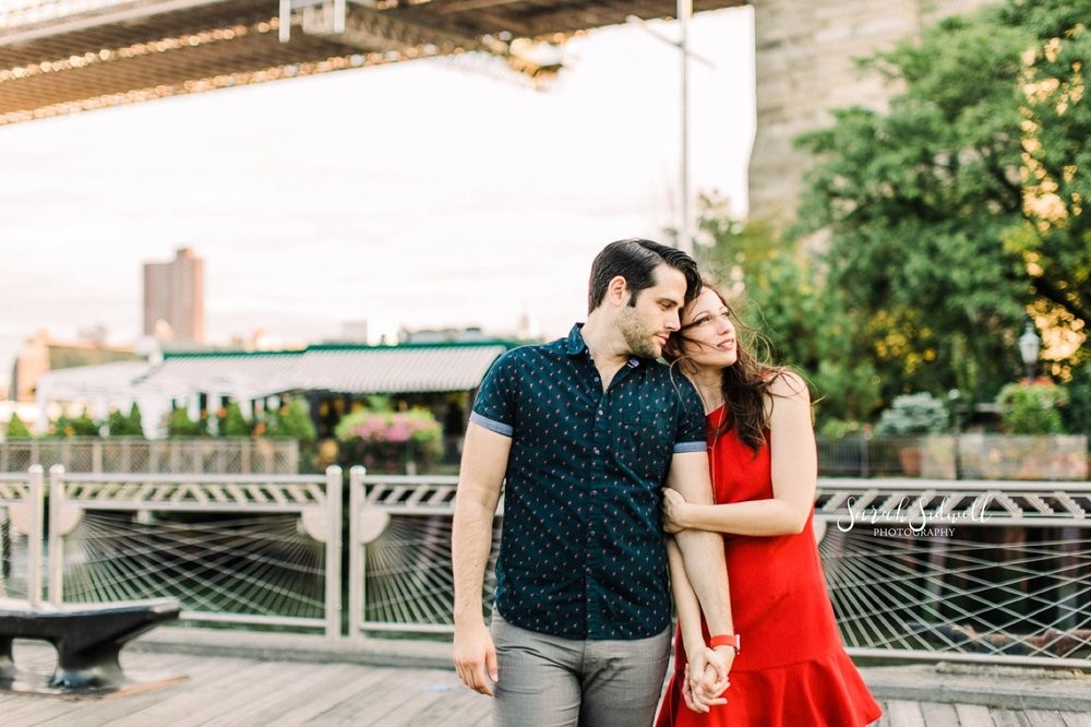 A woman holds onto her fiance.  | Sarah Sidwell Photography | Nashville Engagement Photographer