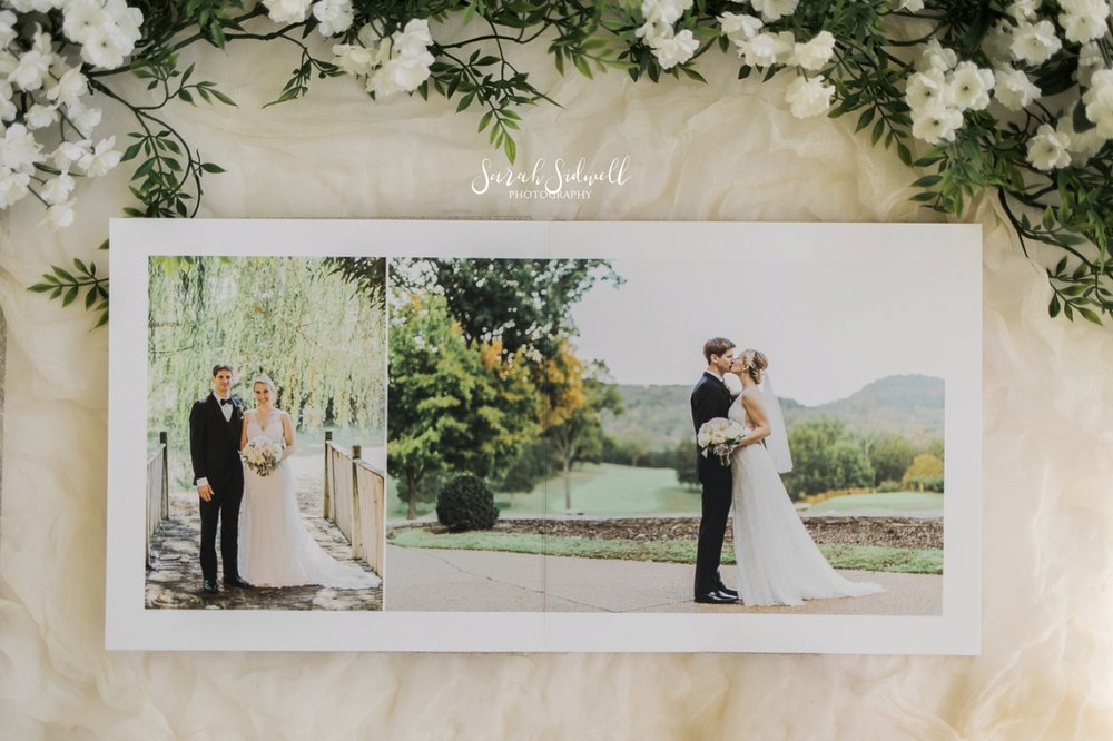 A wedding album sits on a table, opened.