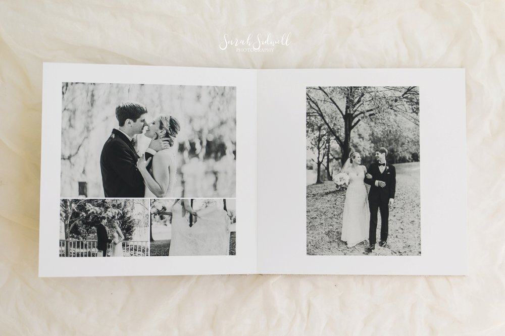 The pages of a wedding photo album are displayed.
