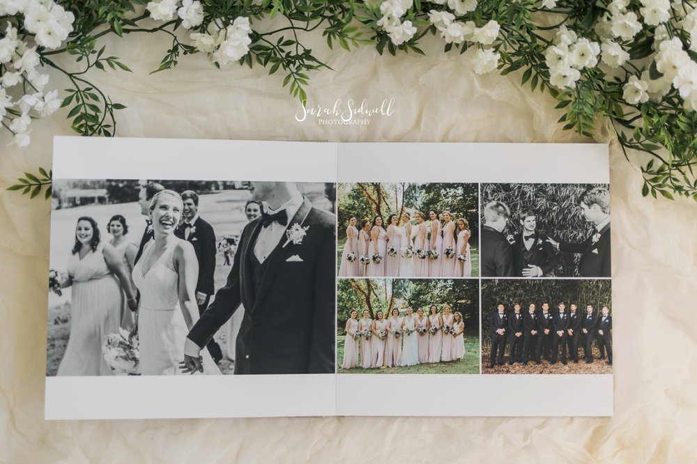 A wedding photo album is turned to a page with a couple holding hands.