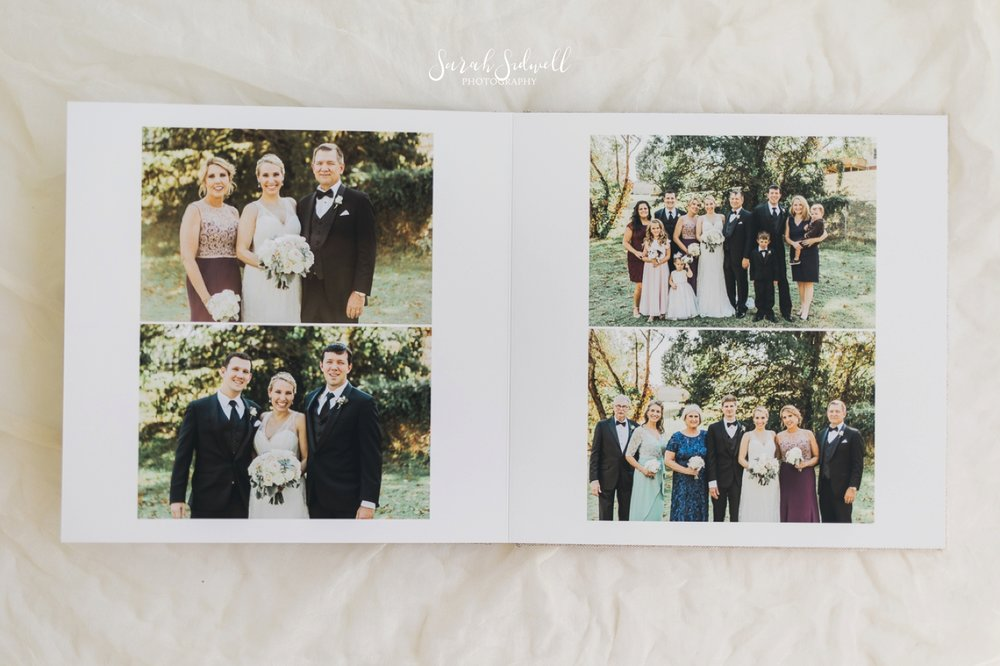 A photographer lays out a wedding album for review.