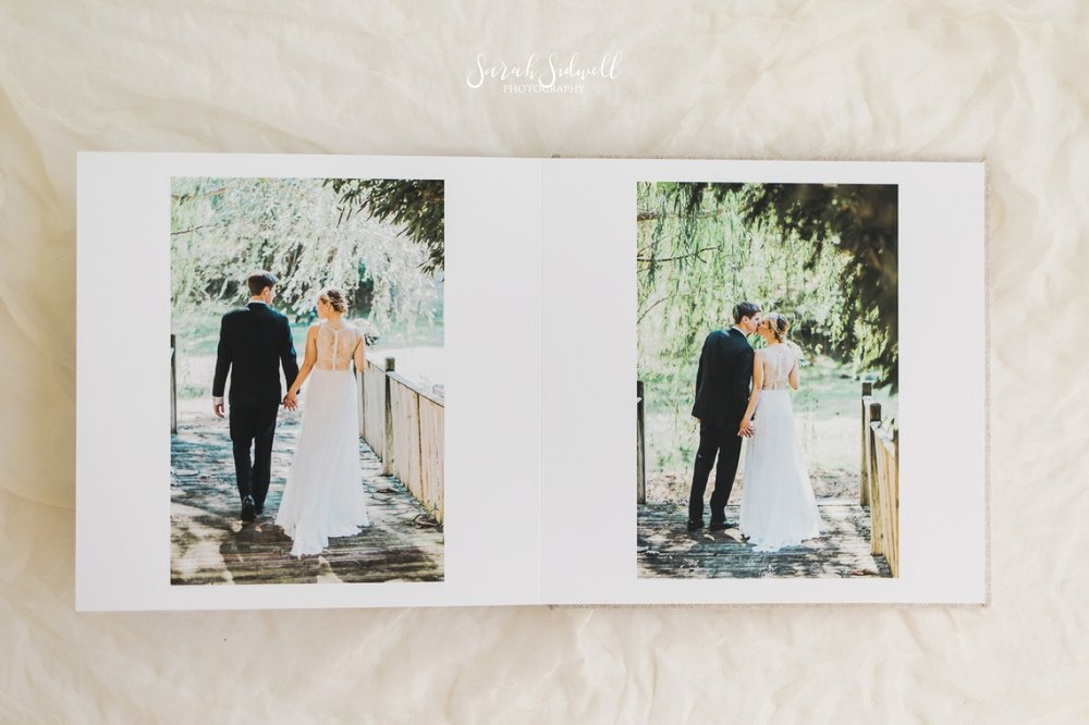 Another page of a wedding photo album is shown.