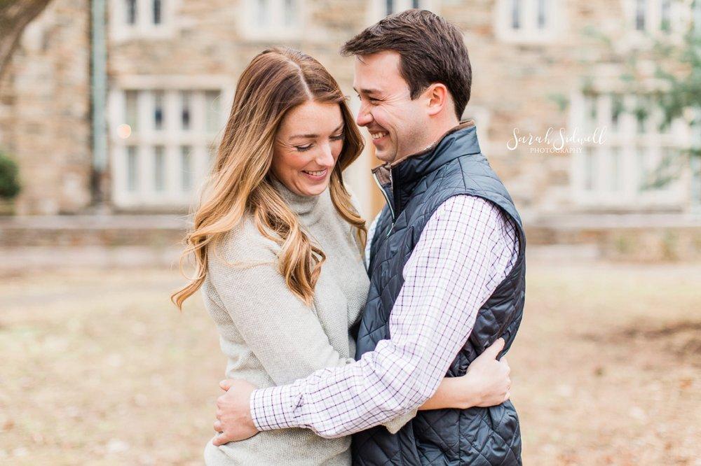A couple laugh together, captured by a Nashville Engagement Photographer