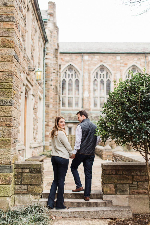 A couple take a walk up some steps.