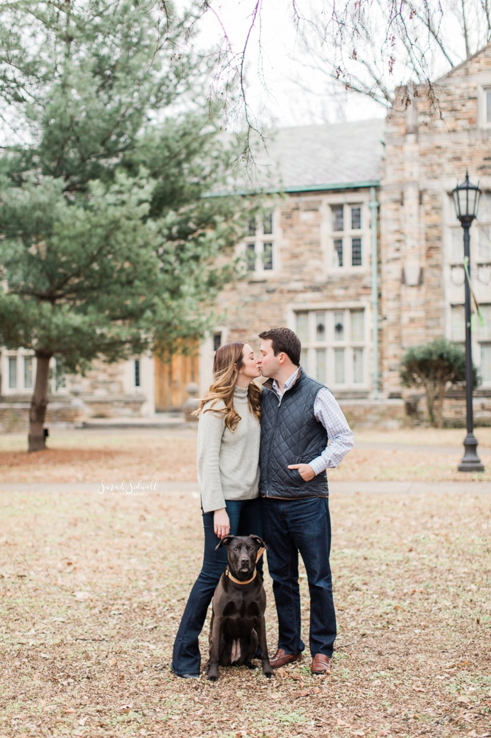 A couple lean into each other while their Nashville engagement photographer captures the moment.