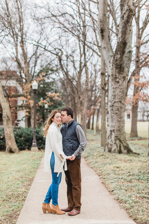 A Nashville engagement photographer captures a couple kissing.