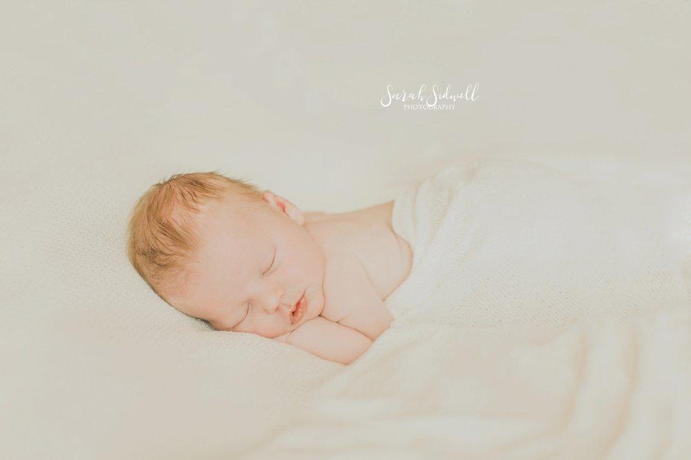 A baby sleeps peacefully.
