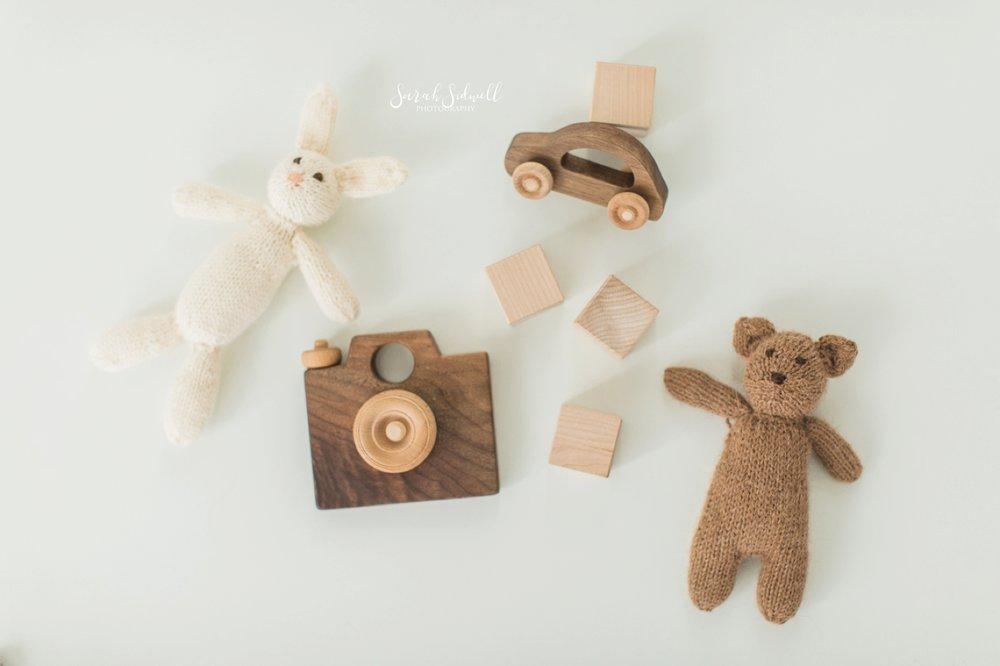 Baby toys lay on a floor.