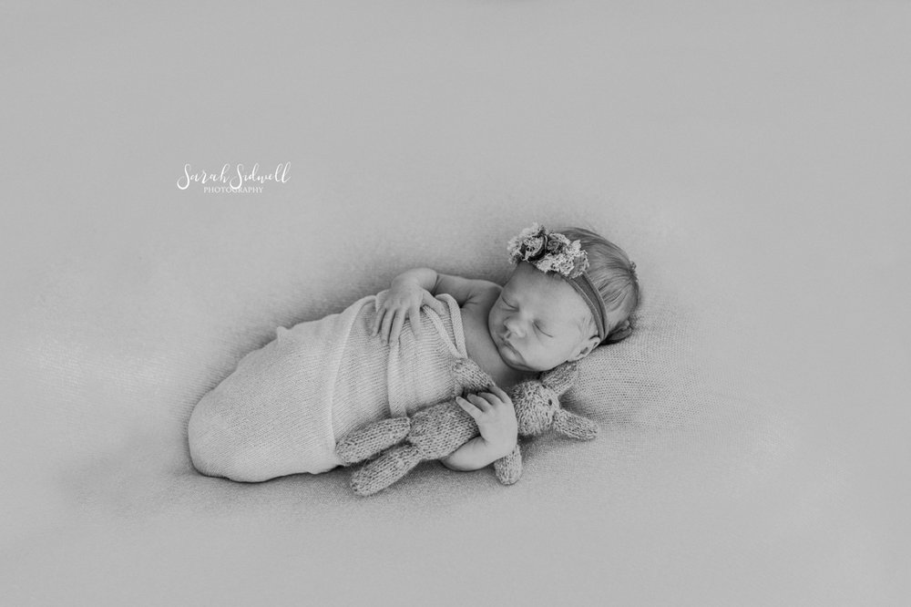 A newborn sleeps peacefully.