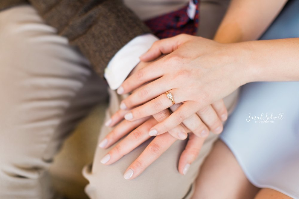 A woman shows off her engagement ring.