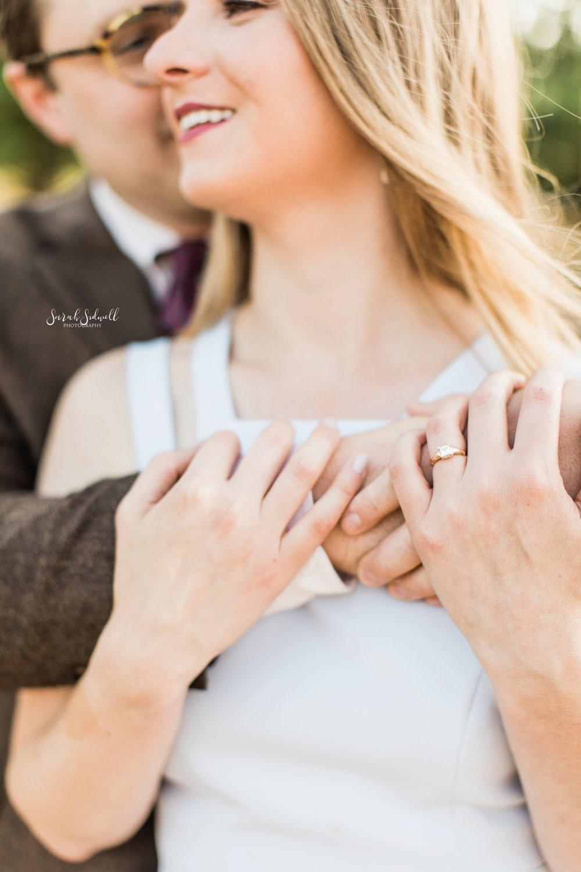 A man hugs his fiance.