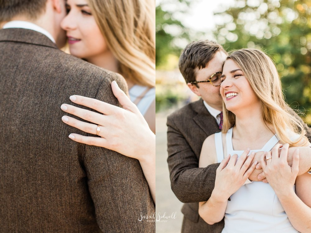 A woman whispers to her fiance.