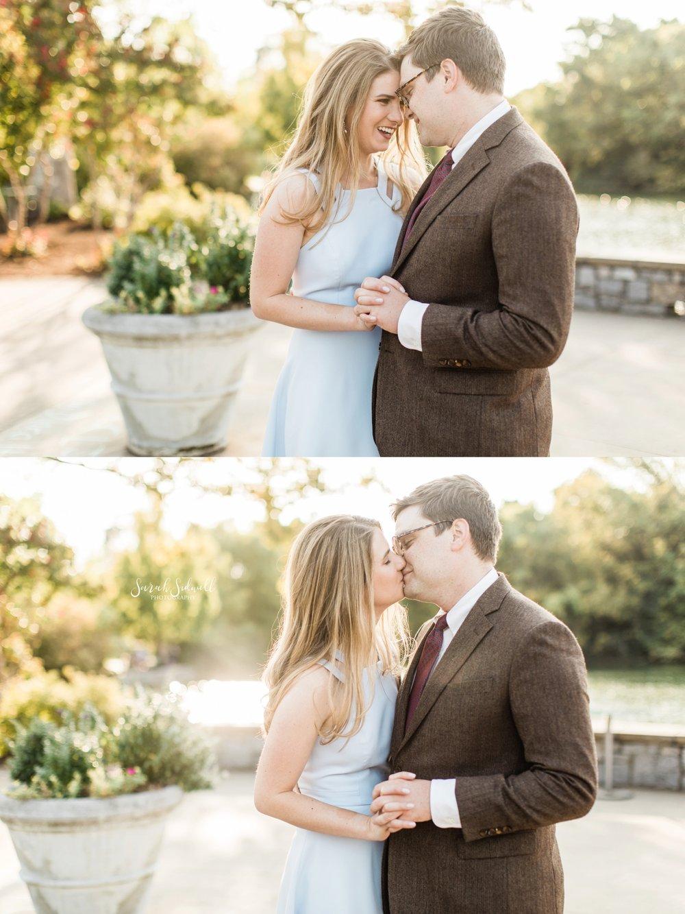 A man kisses his fiance.