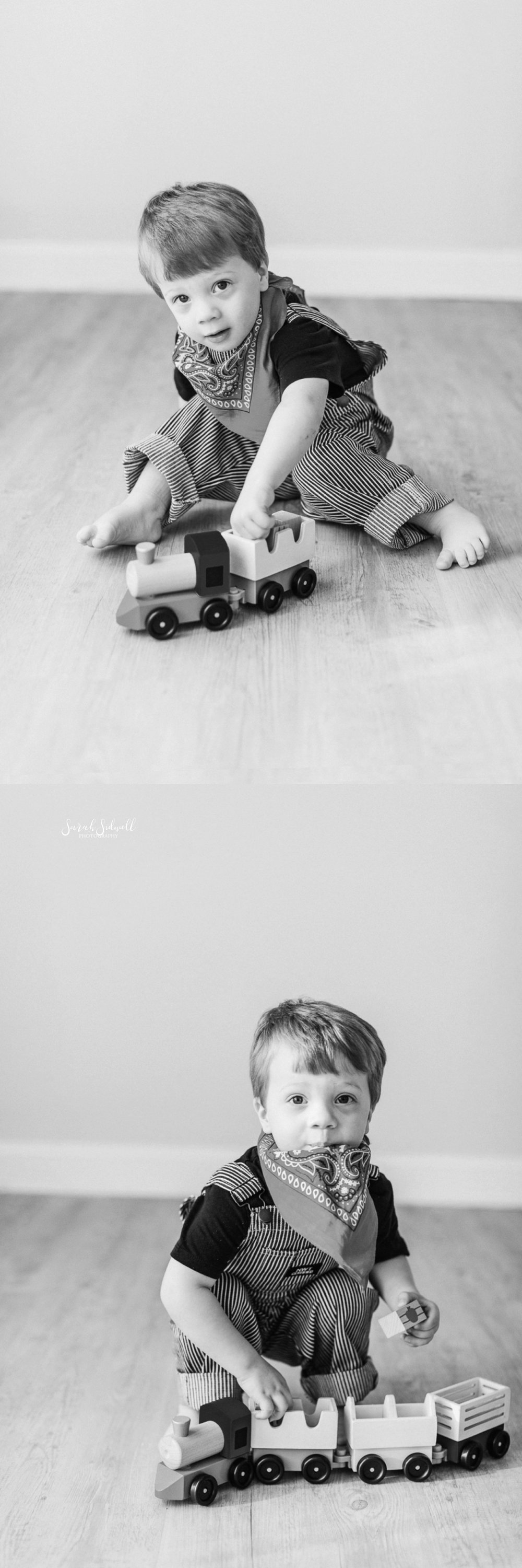 A boy plays with his trains.