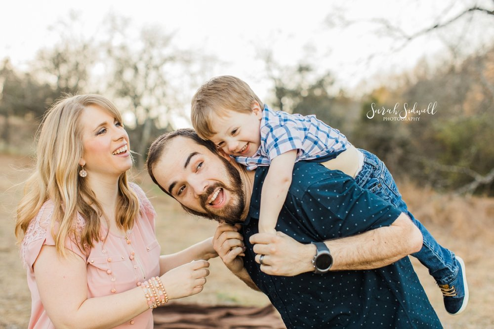 A father gives his son a piggy back ride | Nashville Family Photography
