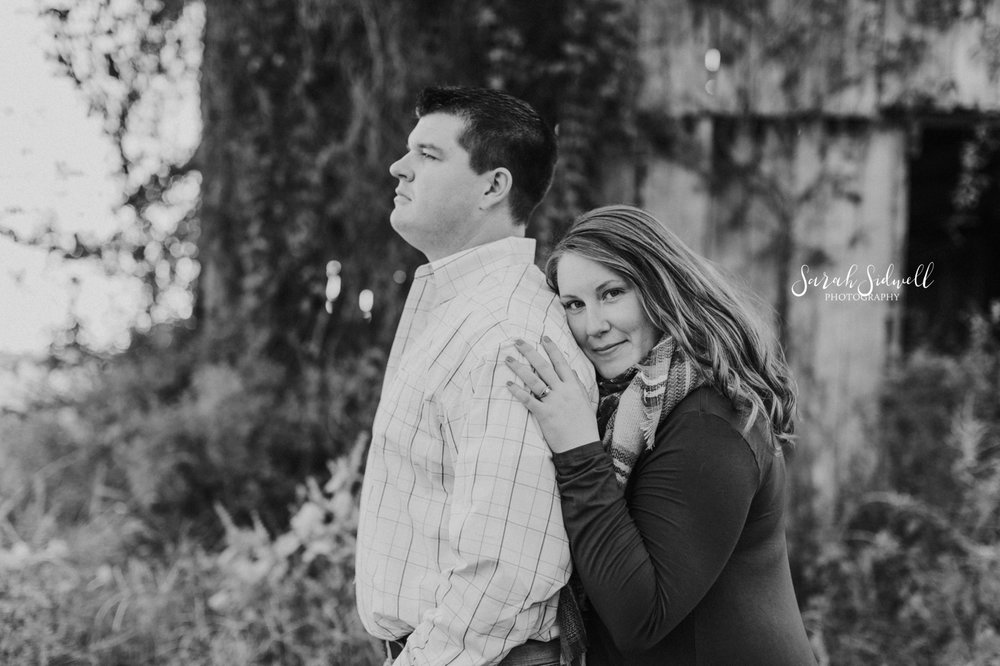 A woman hugs her fiance from behind | Nashville Engagement Photography