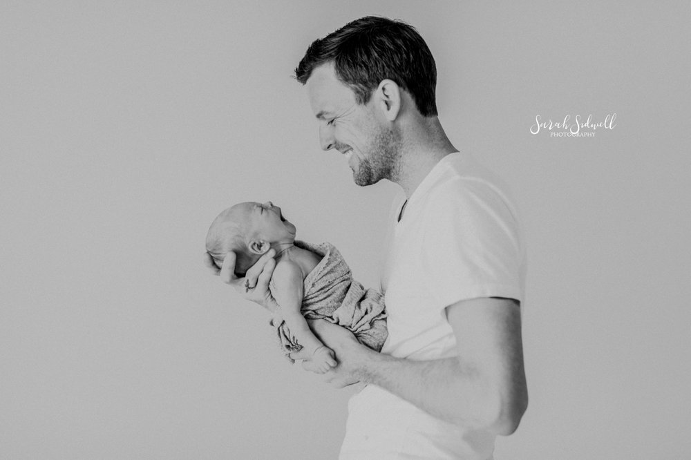 A father talks to his newborn | Newborn Photography Nashville