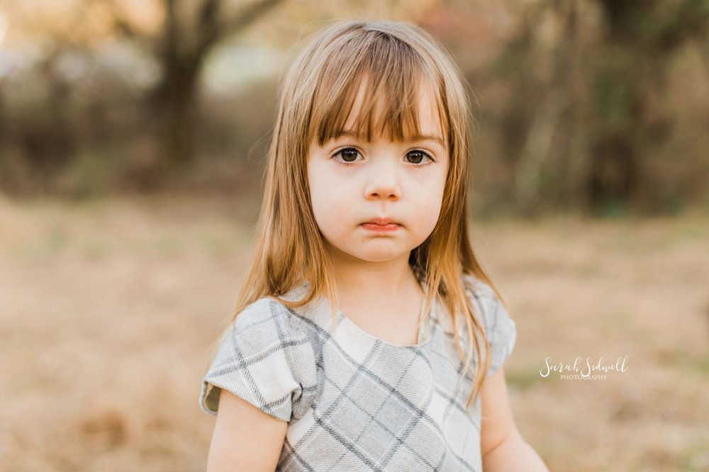 A little girl gives a worried look.