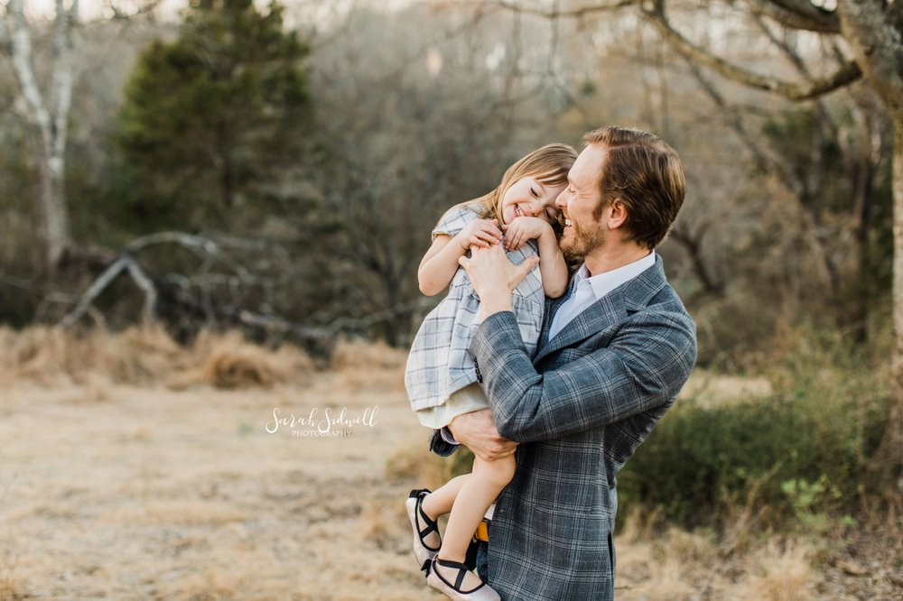 A man holds his daughter | Nashville Family Photos
