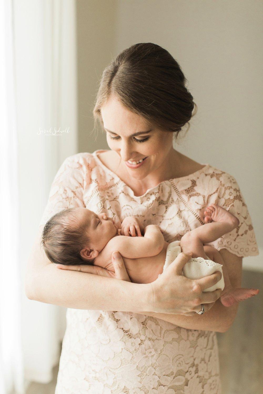 A mother rocks her newborn.