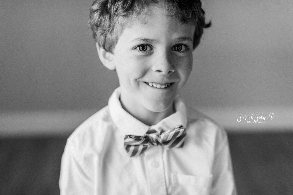 A boy is wearing a bow tie.