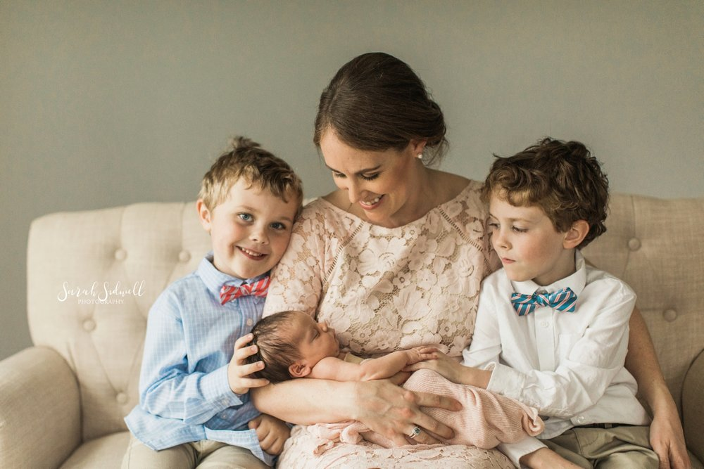 A mother sits with her children | Nashville Newborn Photographer