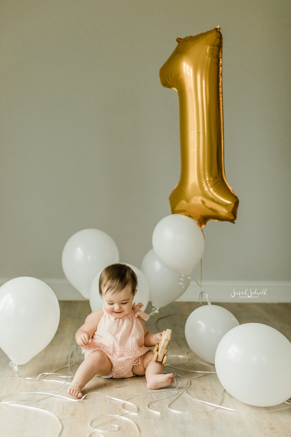 A baby plays with balloons | Nashville Baby Photographer