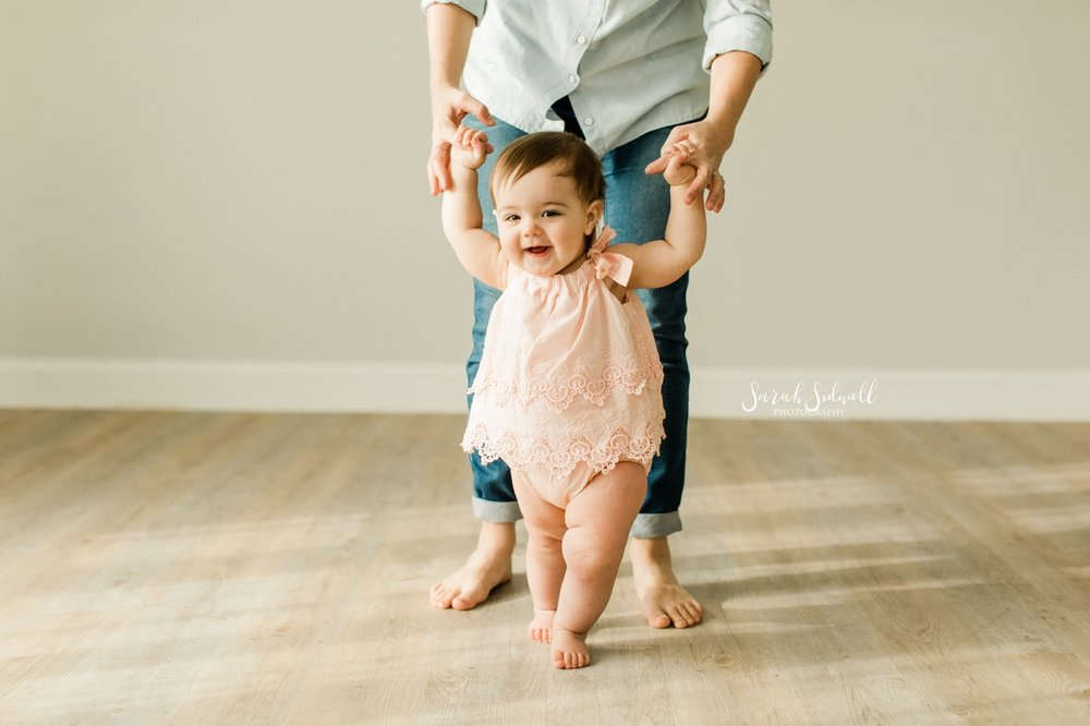 A baby practices walking | Nashville Baby Photographer