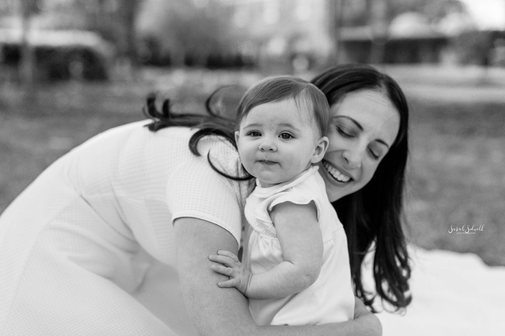 A mom hugs her baby during their Sitting Baby Session In Nashville.